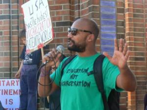 Cages-Kill-Freedom-Rally-Dru-Glover-speaking-Santa-Cruz-012415-by-Lori-Nairne